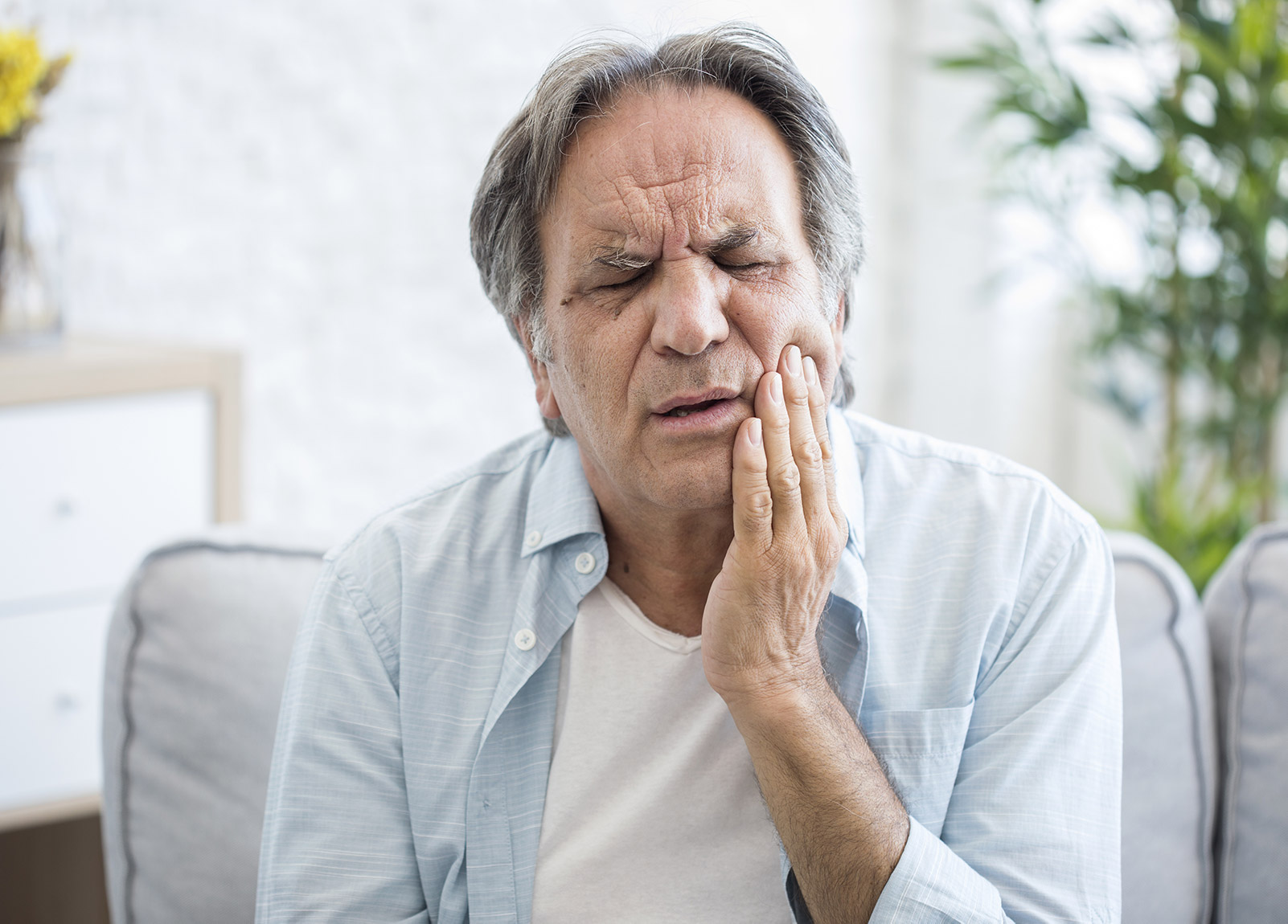 Man with painful tooth ache